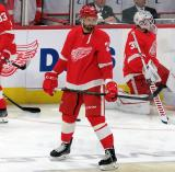 Brendan Perlini of the Detroit Red Wings stands in the neutral zone during pre-game warmups before a game against the Arizona Coyotes.