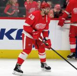 Brendan Perlini of the Detroit Red Wings skates near the boards during pre-game warmups before a game against the Arizona Coyotes.