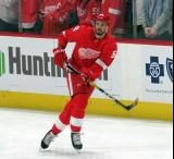 Jonathan Ericsson of the Detroit Red Wings skates near the boards during pre-game warmups before a game between the Red Wings and the Calgary Flames.