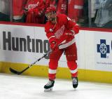 Luke Glendening of the Detroit Red Wings passes a puck during pre-game warmups before a game between the Red Wings and the Calgary Flames.