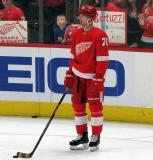 Christoffer Ehn of the Detroit Red Wings stands near the boards during pre-game warmups before a game between the Red Wings and the Calgary Flames.