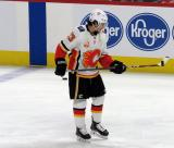 Johnny Gaudreau of the Calgary Flames bounces a puck on his stick during pre-game warmups before a game between the Flames and the Detroit Red Wings.