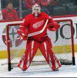 Jimmy Howard of the Detroit Red Wings stands in his crease during pre-game warmups before a game between the Red Wings and the Calgary Flames.