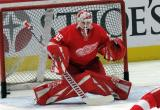 Jimmy Howard of the Detroit Red Wings faces a shot during pre-game warmups before a game between the Red Wings and the Calgary Flames.