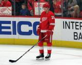 Gustav Lindstrom of the Detroit Red Wings stands near the boards during pre-game warmups before a game between the Red Wings and the Calgary Flames.