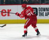 Dylan Larkin of the Detroit Red Wings takes a shot during pre-game warmups before a game between the Red Wings and the Calgary Flames.