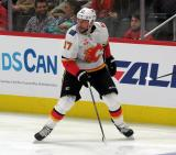 Milan Lucic of the Calgary Flames skates near the boards during a game between the Flames and the Detroit Red Wings.