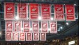 A view of several sets of banners hanging in the Joe Louis Arena rafters.