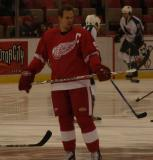 Nicklas Lidstrom checks his stick while standing at the blue line during pregame warmups.