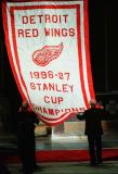 The banner for the Red Wings' 1997 Stanley Cup championship is raised to the rafters of Joe Louis Arena.