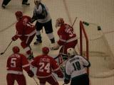 The Red Wings collapse on their own crease as the San Jose Sharks control the puck.