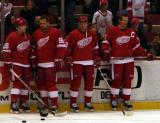 Jiri Hudler, Tomas Holmstrom, Jason Williams and Nicklas Lidstrom stand along the far side boards during pregame warmups.