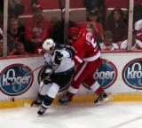 Nicklas Lidstrom battles for the puck in the corner with a Los Angeles King.