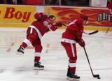 Dan Cleary fires a shot on goal during pregame warmups while Valtteri Filppula carries a puck next to him.