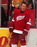 Dan Cleary stands along the boards during pregame warmups, in front of a sign congratulating him on his first career hat trick in the previous game.