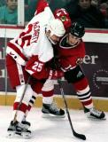 Darren McCarty battles along the boards with a Chicago's Steve Dubinsky.