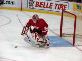 Dominik Hasek knocks aside a shot during pregame warmups.