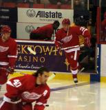 Jason Williams jumps onto the ice for pregame warmups as Johan Franzen skates at the blue line and Henrik Zetterberg cuts to the net.
