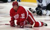 Niklas Kronwall stretches at center ice during pregame warmups.
