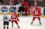 Nicklas Lidstrom fights for the puck with Anaheim's Corey Perry, with Johan Franzen and Kris Draper looking to provide support.