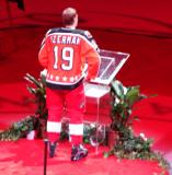 Nicklas Lidstrom, wearing Steve Yzerman's Campbell Conference All-Star jersey, speaks to the crowd at the ceremony for Yzerman's number retirement.