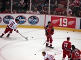 The Red Wings participate in pregame warmups wearing past jerseys of Steve Yzerman as part of the ceremony for Yzerman's number retirement.  Kirk Maltby and Kris Draper are in Team Canada jerseys, Robert Lang and Henrik Zetterberg are in Campbell Conference All-Star jerseys, and Tomas Holmstrom is in a 2002 Detroit Red Wings jersey.
