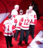 Gordie Howe joins Ted Lindsay, Alex Delvecchio, and family representatives of Terry Sawchuk and Sid Abel on the red carpet at the ceremony for Steve Yzerman's number retirement.