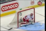 Dominik Hasek stops Colorado's Wojtek Wolski on a shootout attempt.
